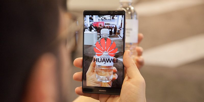 Augmented reality welcome for guests as they enter a technology event